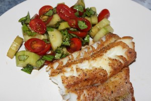 Cod with a basil tomato cucumber salad on the side